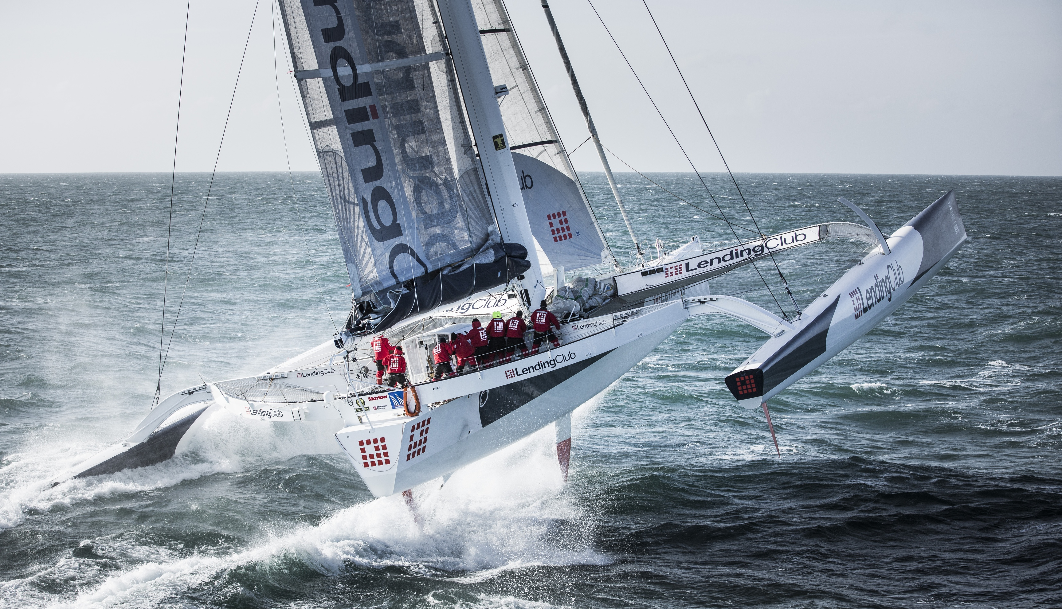 The Lending Club maxi trimaran skippered by Ryan Breymaer. show here in action as they try and break the world record for sailing non stop from Cowes - Dinard in France Credit - Lloyd Images